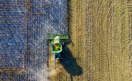 aerial-shot-of-green-milling-tractor-1595108