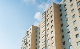 beige-low-angle-photo-high-rise-building-3029037